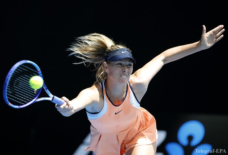 epa05126041 Maria Sharapova of Russia plays a shot against Serena Williams of the US during their quarter finals match at the Australian Open tennis tournament in Melbourne, Australia, 26 January 2016.  EPA/MAST IRHAM