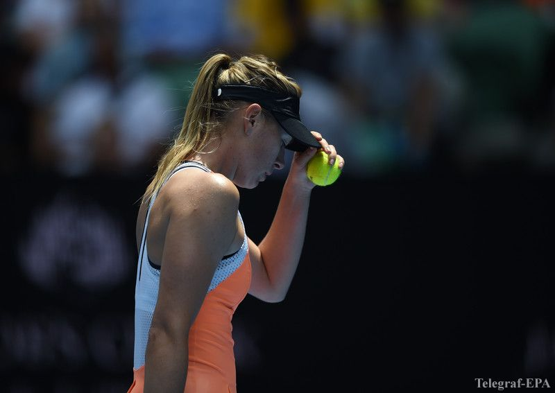epa05126123 Maria Sharapova of Russia adjusts her cap during play against Serena Williams of the United States in their quarter finals round on day nine of the Australian Open tennis tournament in Melbourne, Australia, 26 January 2016.  EPA/LUKAS COCH AUSTRALIA AND NEW ZEALAND OUT