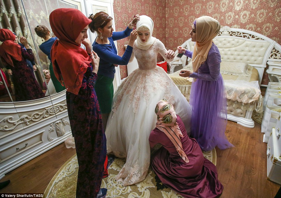 3ab7381700000578-3968480-her_friends_also_wearing_traditional_chechen_dress_crowd_around_-a-47_1480006899326