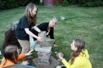 Children's Circle creating a solstice stone structure to catch the summer sunrise.