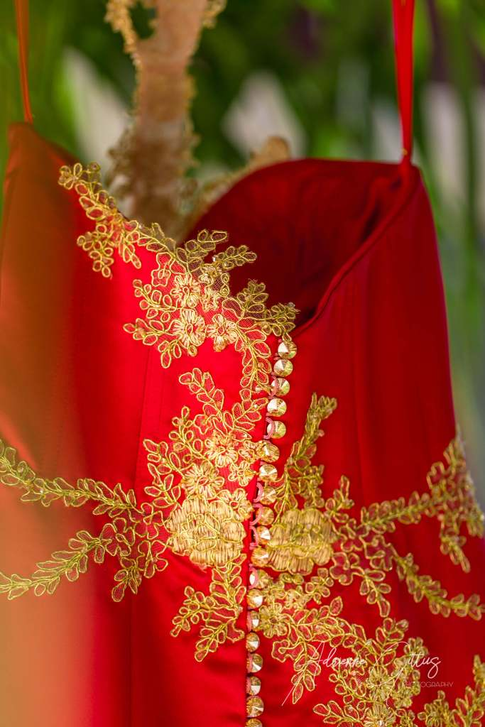 chinese dress detail buttons and gold embroidery on red dress