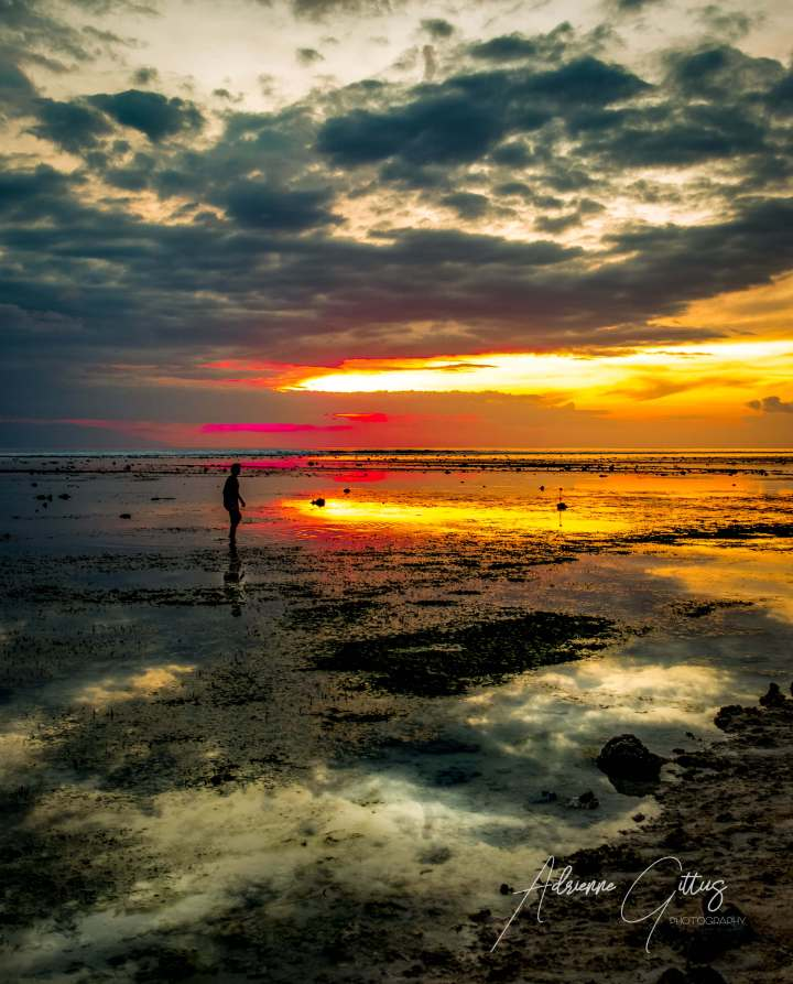 Beautiful sunset with the reflection in rock pools at low tide