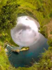 360 camera Wormhole overlooking beautiful turquoise water and cliffs at Atuh Beach, Nusa Penida, Bali, Indonesia