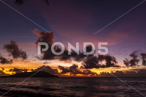 Beautiful sunset over ocean, pink purple orange yellow, golden hour