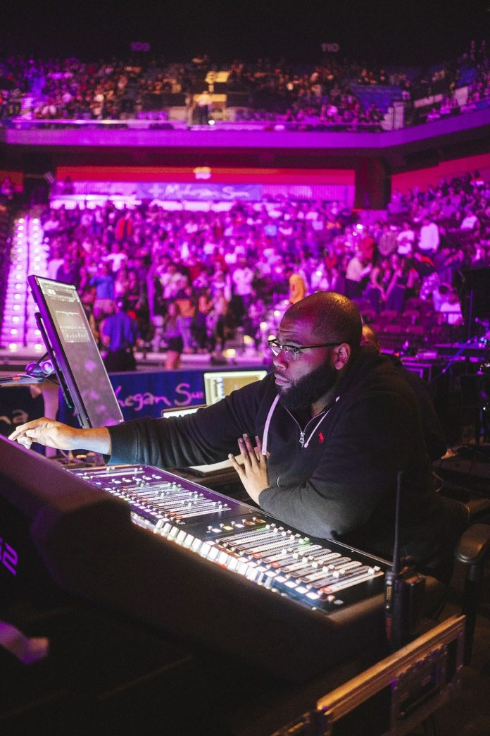FOH Engineer Brandon Blackwell manning the tour's DiGiCo SD12