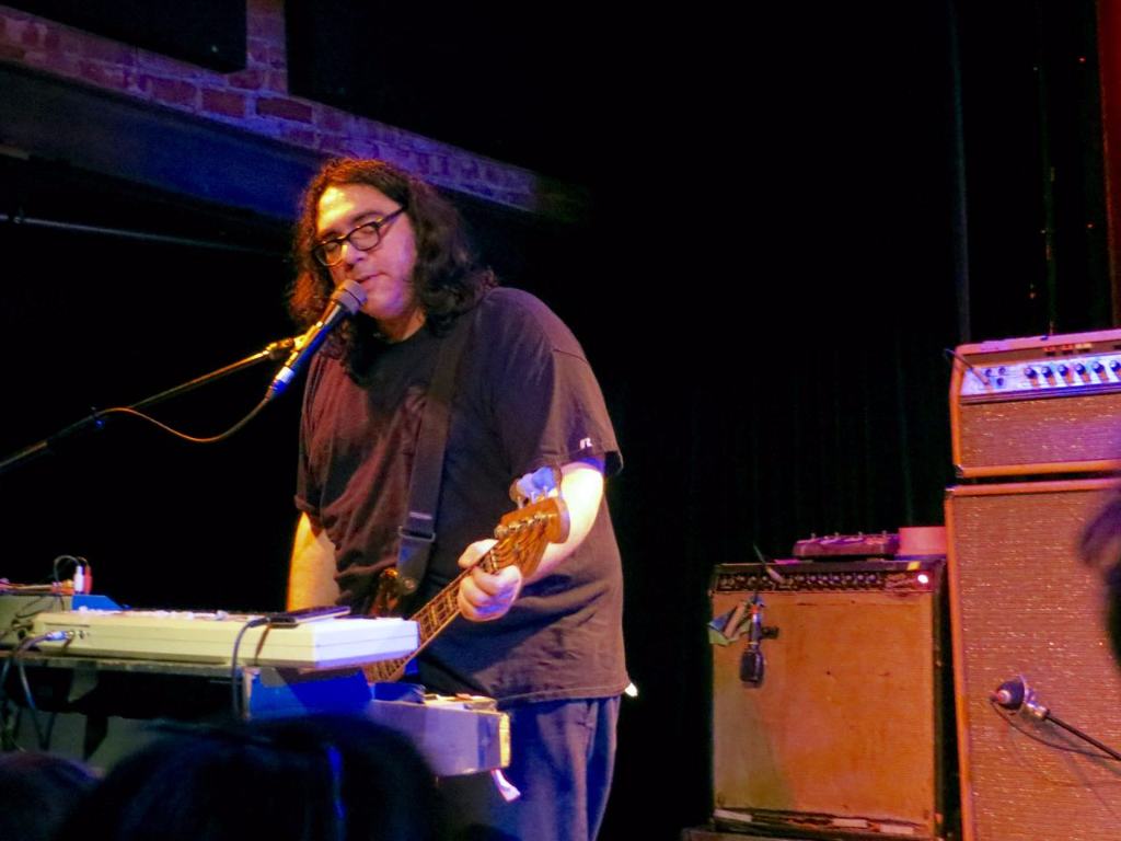 Yo La Tengo on stage at Helsinki Hudson;, James McNew  playing bass and singing in front of organ