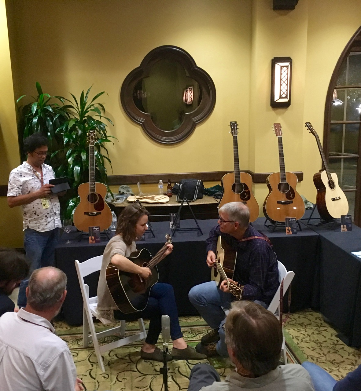 Courtney Hartman and Scott Nygard playing together at the Bourgeois booth