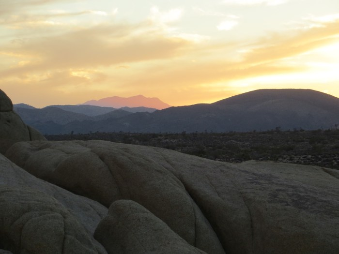 Purple mountain in the distance over Jumbo Rocks, Joshua Tree