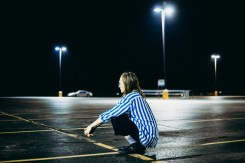In an Iowa parking lot, Shane enjoys the plethora of space afforded by a brief exit from the confines of the van.