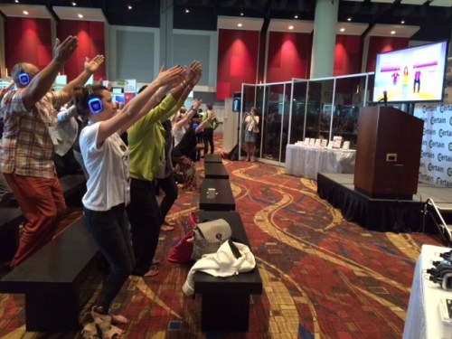 Conference attendees participating in an X Bytes video