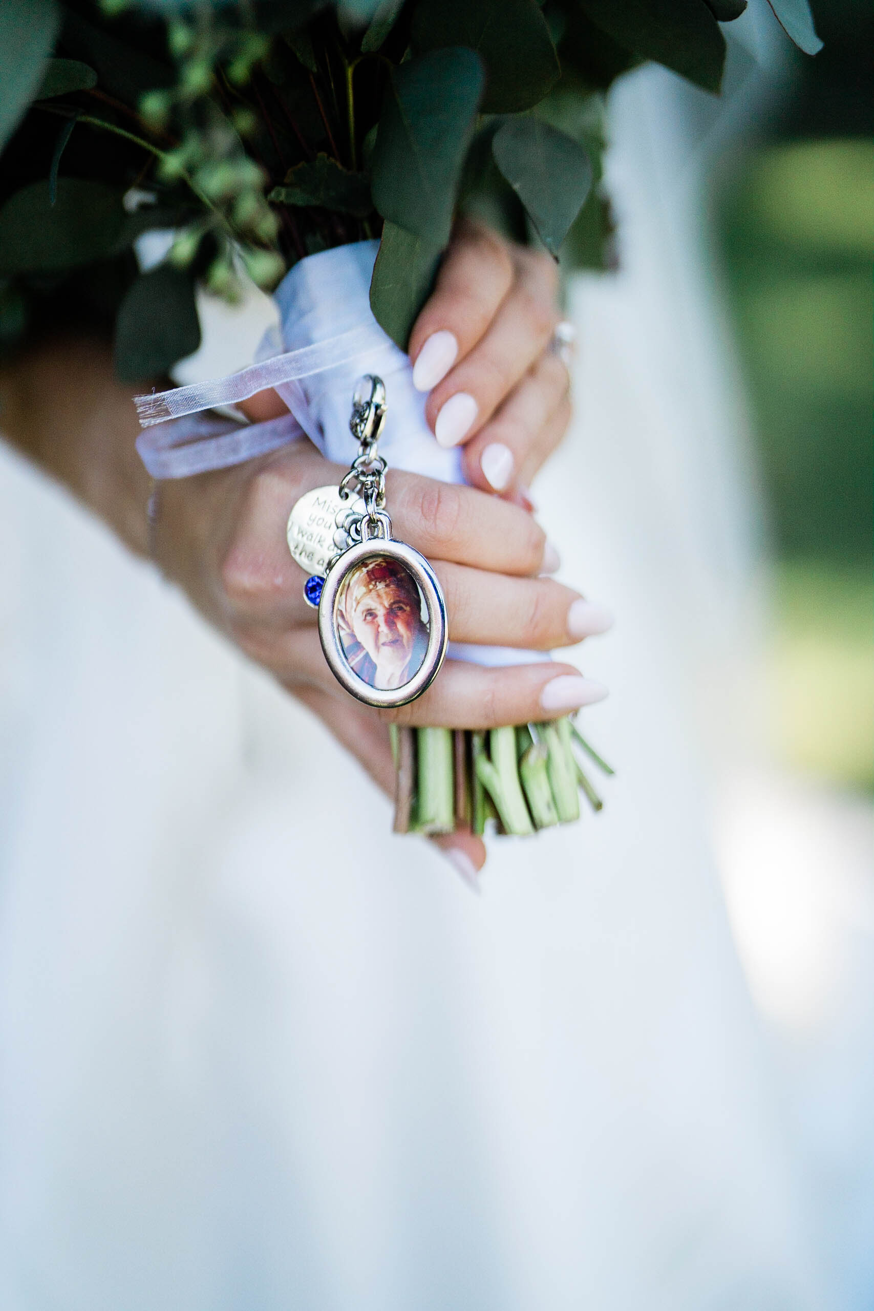 bride shows flowers at craven farm wedding with photographers in seattle