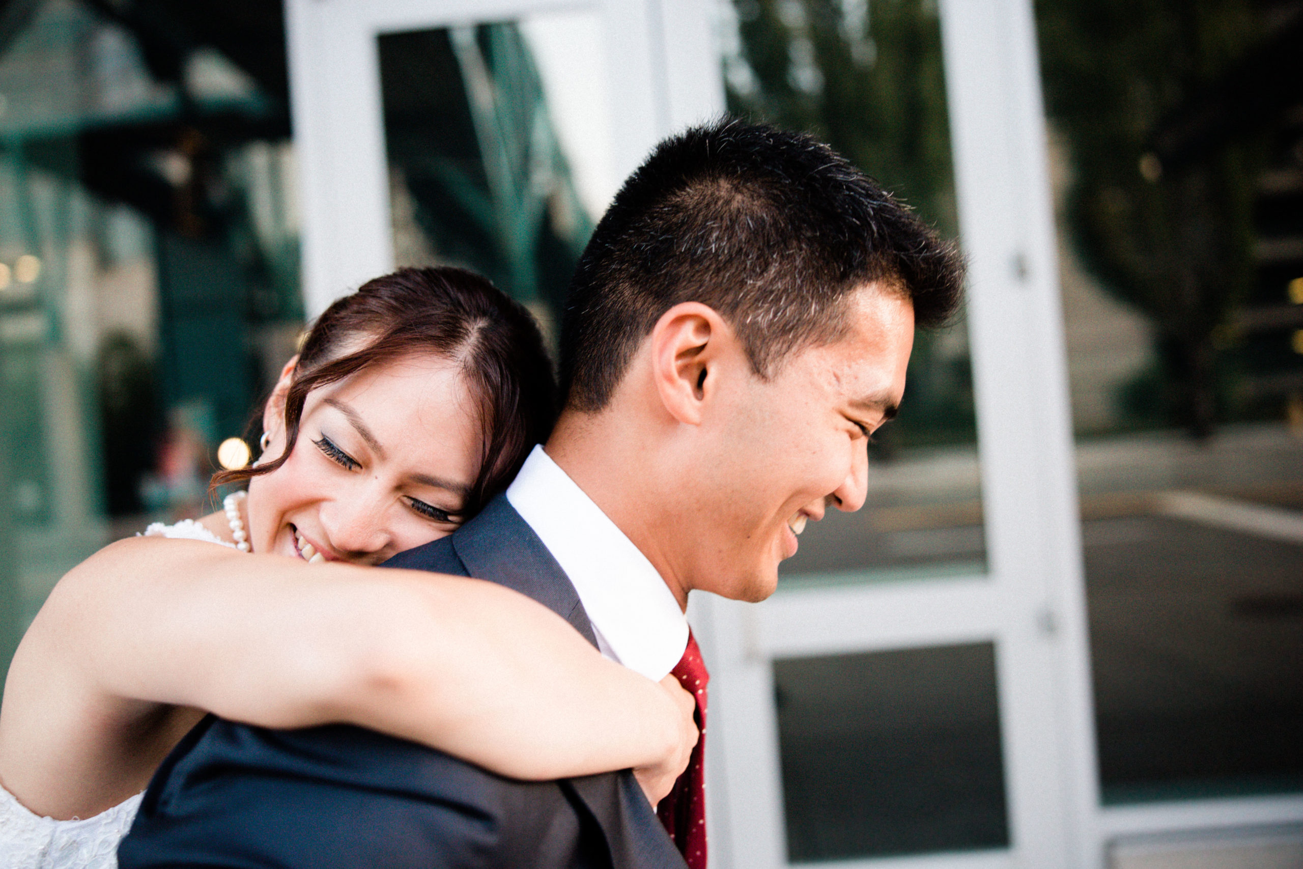 wife hugs husband after getting married at edgewater hotel