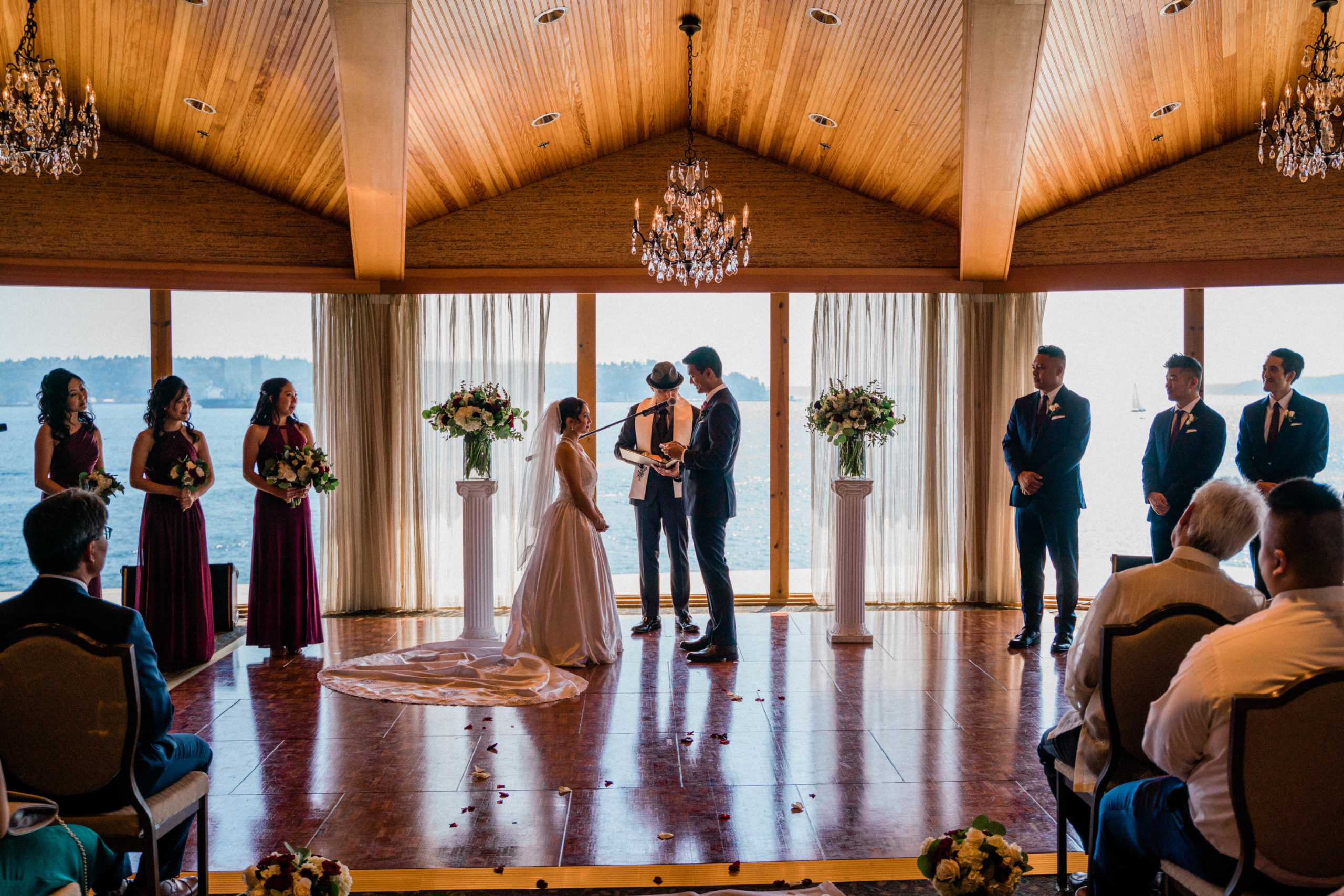 edgewater hotel wedding ceremony ballroom with huge windows overlooking Puget Sound with olympic mountain views