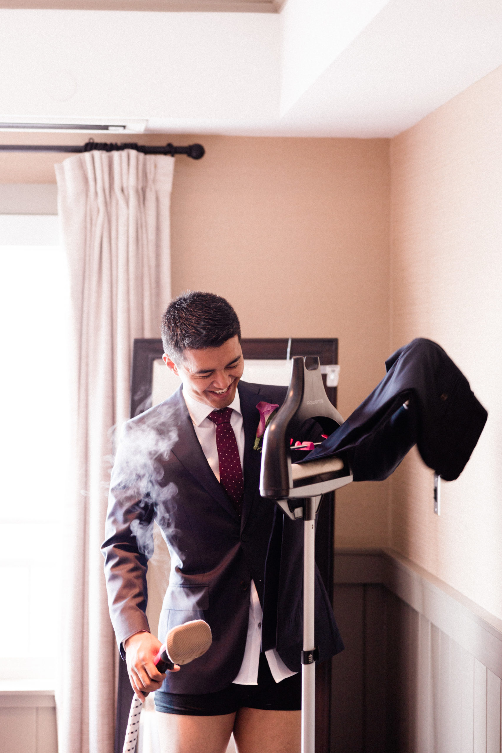 Groom ironing his tuxedo pants before walking down the aisle