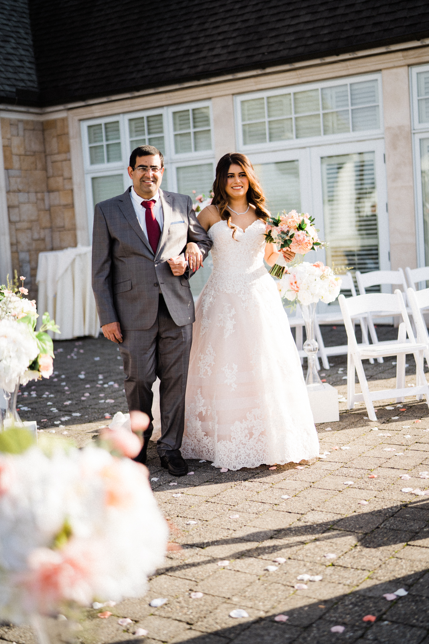 father walks daughter down the aisle at outside wedding venue at Newcastle golf club in Renton