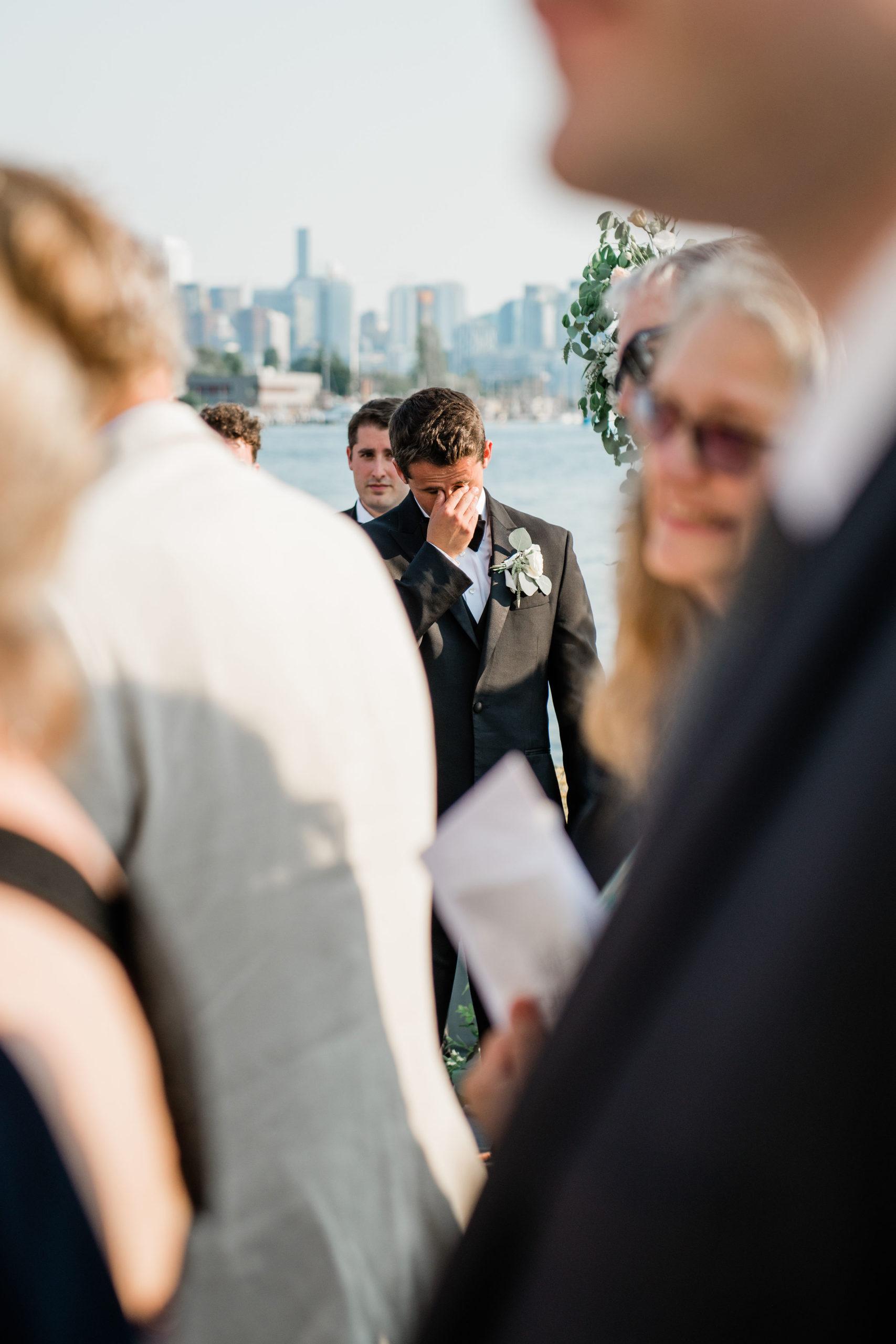 Groom cries while bride walks down the aisle on board MV Sk