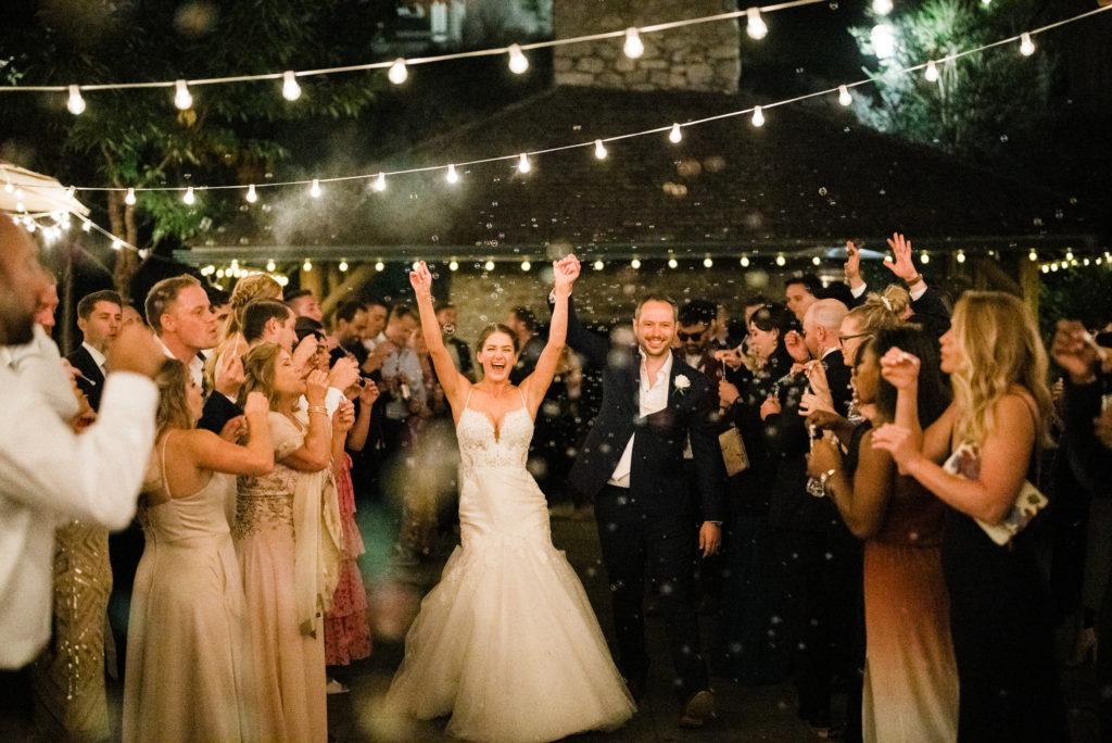 grand exit at Roche Harbor Resort wedding photos