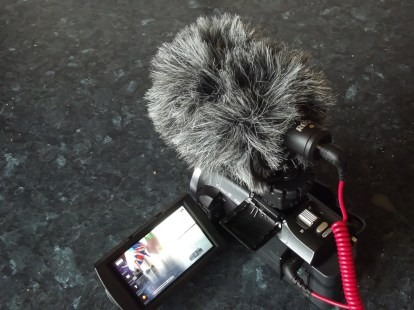 Sony FDR-PJ620 with ROde VideoMicro mounted.