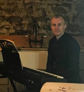 Craig Sutcliffe on the piano