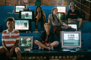 a variety of teens sitting next to computer monitors. They are entering a time of adolescent identity development