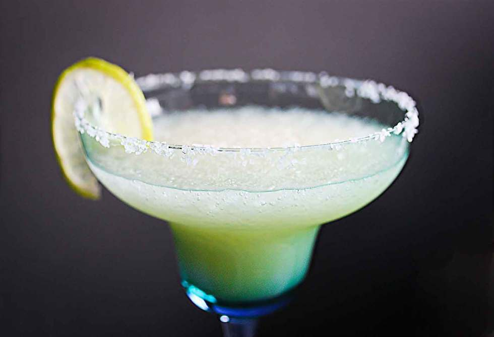 New Year's Margarita with a lime wedge in a glass