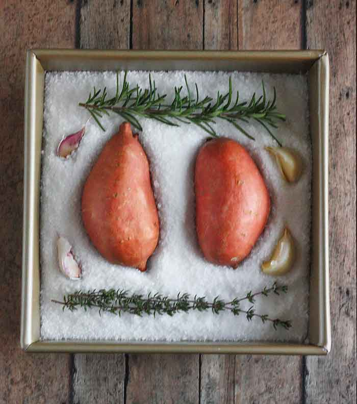 Two sweet potatoes ready to be salt roasted