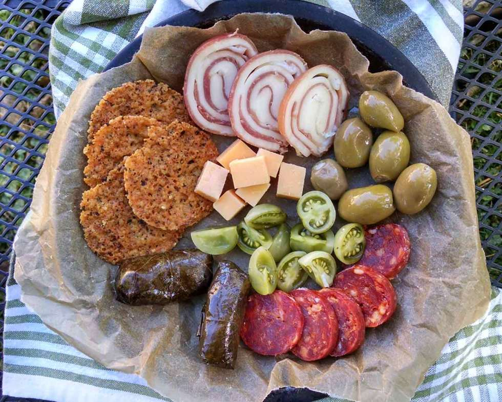 Charcuterie board with green tomato pickles