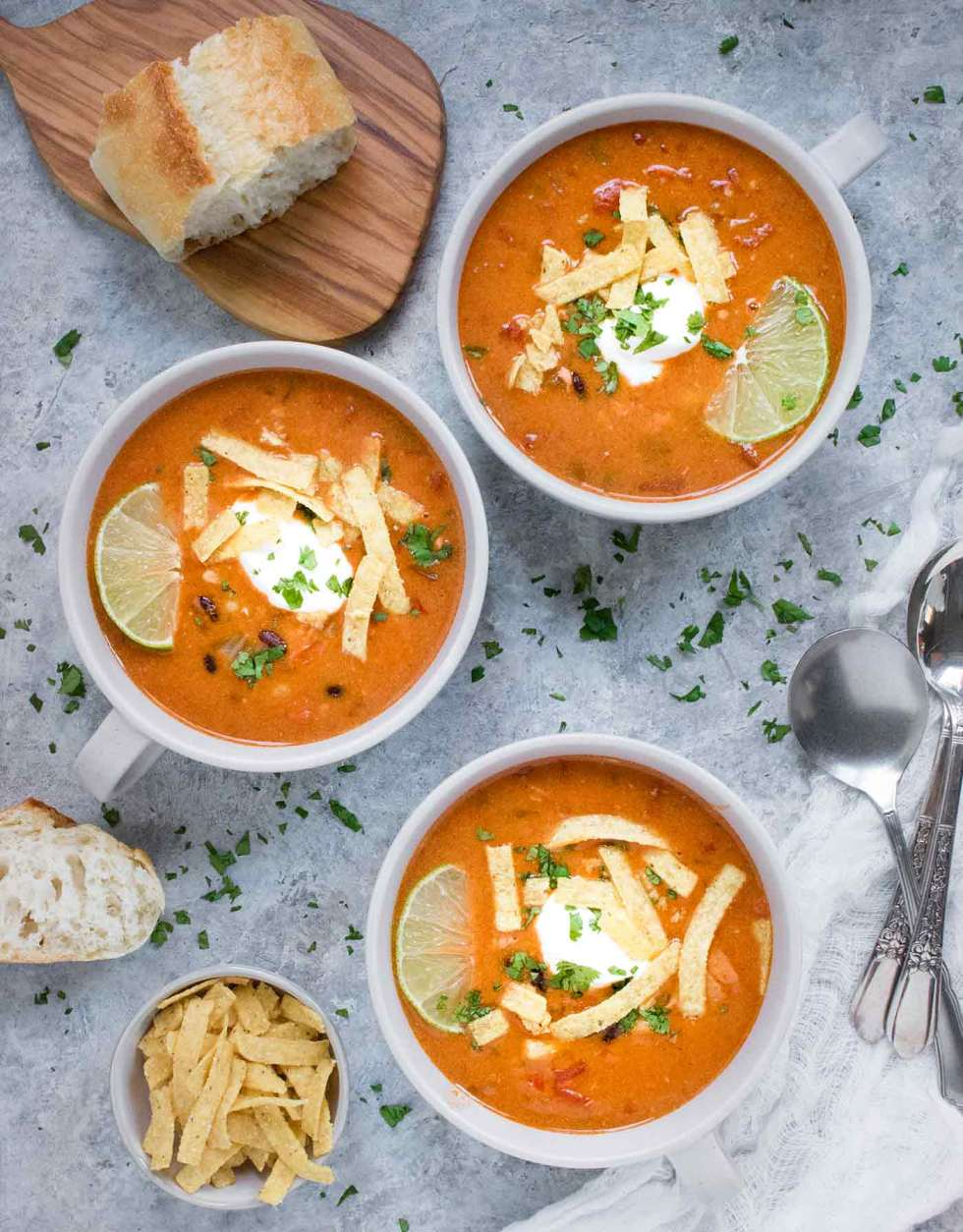 Three bowls of Instant Pot Chicken Tortilla Soup
