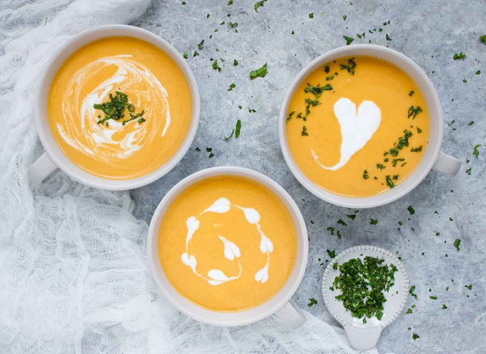 Three bowls of Carrot Lemongrass Soup, made in the Instant Pot