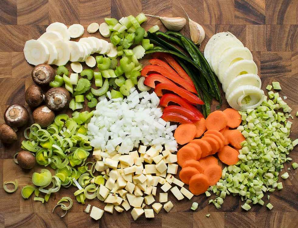 Chopped vegetables on cutting board for Vegetable Dumpling Soup.