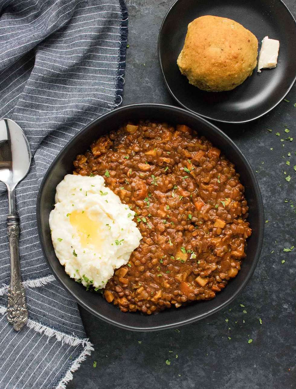 Vegetarian Irish Stew for lentil lovers in a bowl, topped with mashed potatoes