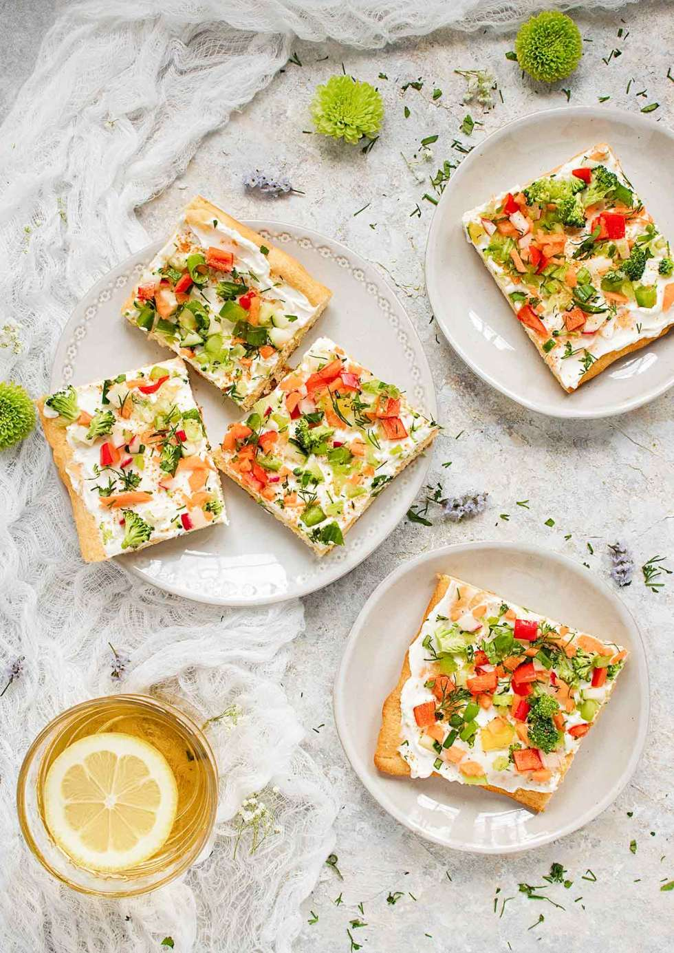 Appetizer plates filled with Ranch Veggie Pizza squares