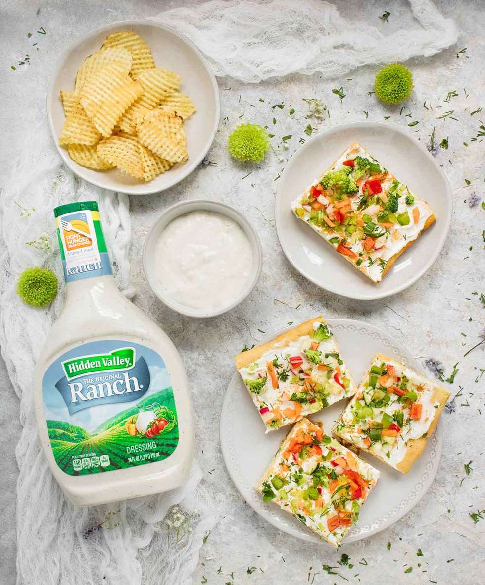 Ranch Veggie Pizza squares with chips and dip