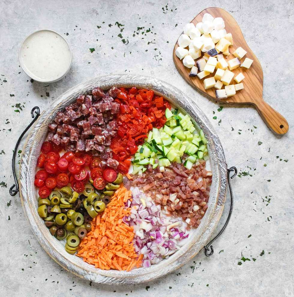 Ingredients for Italian Pasta Salad on a serving board