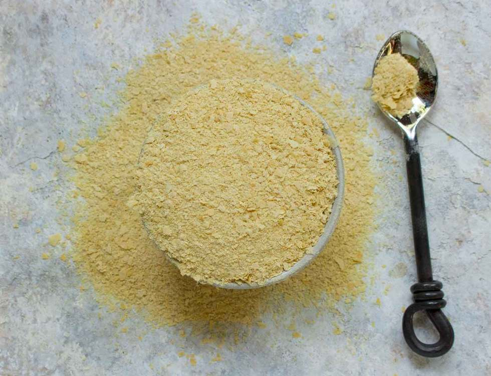 Nutritional Yeast flakes in a bowl