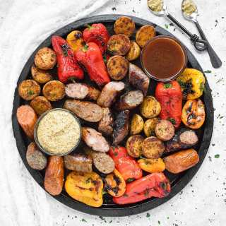 Grilled Sausages, Peppers & Potatoes with mustard and bbq dipping sauces