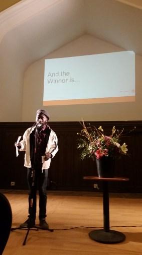 Mario Quinn accepts his prize