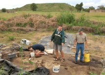 Researchers comb through a 40-by-40-foot area in Mound 34, which lies just east of Monks Mound (seen in background). (David Kilper)