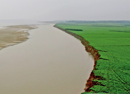 """Known as the """"cradle of Chinese civilization,"""" the Yellow River was the birthplace of the prosperous northern Chinese civilizations in early Chinese history. However, the Yellow River is also referred to as """"China's Sorrow,"""" because of its frequent and devastating flooding. (Courtesy Photo)"""