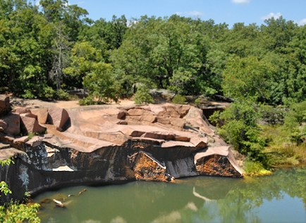 The granite used on Green Hall is found some 100 miles southwest of St. Louis. Elephant Rocks State Park (pictured above), which is near the quarries, beautifully exhibits the red stone. (David Kilper)