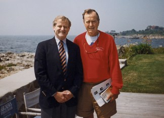 "While at the CIA, John Gannon (left) met with foreign and U.S. officials, including President George H.W. Bush, who, Gannon says, was ""particularly gracious and 'analyst-friendly'; he loved to get a 'gaggle' of analysts around him and be briefed by them."" (Courtesy Photo)"