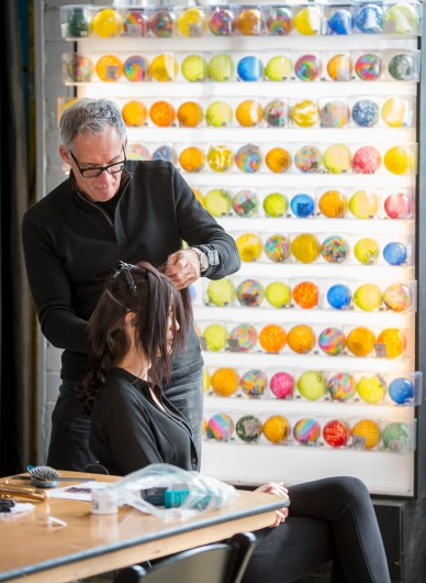 Dominic Bertani of the Dominic Michael Salon preps Emily Helling of CENTRO Models. (Photo: Joe Angeles/Washington University)