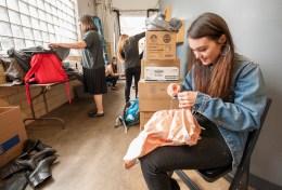 Designer Ella Young adjusts a pair of slacks. (Photo: Joe Angeles/Washington University)