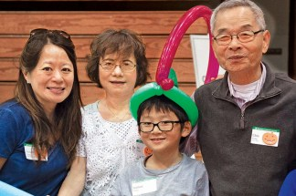From left: Susan Yang, MD '97; Su Ling Yang; Nathan Wang; and Chia Yang, MA '67, PhD '71, attend the 2016 Fall Festival. (Sid Hastings/Washington University)