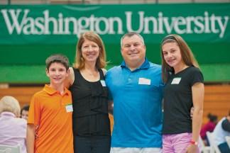 Robert Kilo, BSBA '92, his wife, Kathy, and their children, Nicholas and Caroline, enjoy Fall Festival activities. (Sid Hastings/Washington University)