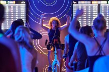 Cycling instructor Meghann Feely, assistant director of fitness and wellness, models her spinning classes after the popular fitness craze SoulCycle. (Dan Donovan/Washington University)