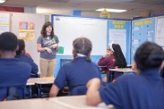 Anisa (Baldwin Metzger) Heming talking about green building with a class of students at a New Orleans junior high school.