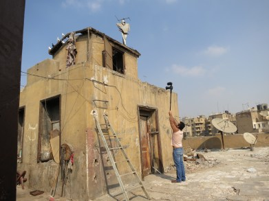 Taksler hired a local crew to help her film Tickling Giants. Here, a cameraman films in Cairo, Egypt.