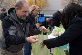 employees help at a food bank