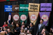 Family and friends celebrate graduating students in front of school banners during the university's December Degree Candidate Recognition Ceremony Dec. 2. (Photo: Sid Hastings/Washington University)